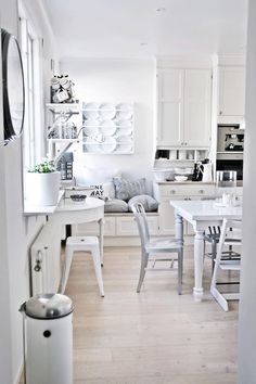 LOVE this. esp the floors and all the white, but look at that cute bench nook!