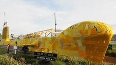 An ornamental submarine in Holbrook, NSW, has been yarn-bombed to turn it into a yellow knitted submarine