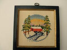 vintage framed cross stitch- bridge, stream, river, pine trees. $9.95, via Etsy.