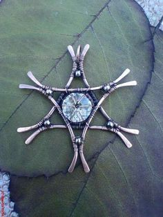 Snowflake pendant by Chestell Carcass.