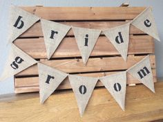 A personal favourite from my Etsy shop https://www.etsy.com/uk/listing/279713860/bride-groom-hessian-mini-bunting-wedding