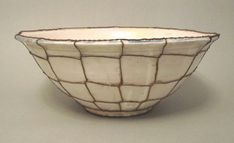 Large white bowl from Seville, c.1820. The hand woven wire web holds the many cracks in the ceramic together, enabling the bowl to be functional again.