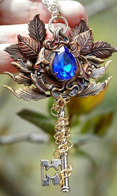 Beautiful blue jewel with rusty gold leaves Key Jewelry, Fairy Jewelry, Fantasy Jewelry, Cute Jewelry, Jewelery, Jewelry Accessories, Magical Jewelry, Keys Art, Key Necklace