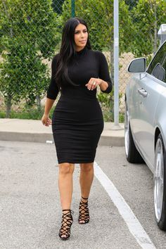 Pin for Later: Kim Kardashian's Second Child Has Arrived!  For a shopping outing, Kim kept it simple but no less sexy in a snug black sheath dress and strappy lace-up heels.