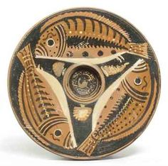 AN APULIAN RED-FIGURED FISH PLATE   ATTRIBUTED TO THE EYEBROW PAINTER, CIRCA 350-330 B.C.
