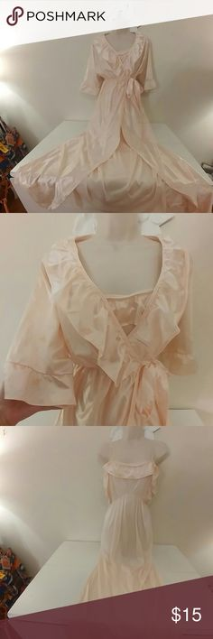 Vintage 70s ruffled peach peignoir set Vintage 70s ruffled peach peignoir set. , Robe has attached belt, and no flaws.  Nightgown's upper elastic is a little loose which has the effect of showing side boob (pic 4) but no other flaws.  Very pretty, girly set.  Size small.  Made in USA.    Price firm unless bundled.  Please see my closet for lots of other fun and vintage lingerie! 20% off bundles! Vintage Intimates & Sleepwear Robes