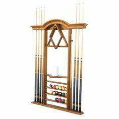 """Fully equip your billiards room with this stunning wall-mount pool cue rack, showcasing 8 slots and 4 ball racks.  Product: Pool cue rackConstruction Material: WoodColor: Honey mapleFeatures:  Wall-mountedHolds up to eight cues, one set of pool balls, and most other pool accessoriesConcealed hardware Dimensions: 52"""" H x 37.25"""" W x 4"""" DNote: Light assembly required. Mounting brackets not included."""