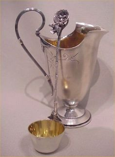 "Gorham ""Bird's Nest"" pattern sterling silver bucket form cream ladle, with a Wood & Hughes sterling cream pitcher, c1870's (Burchard Galleries)"