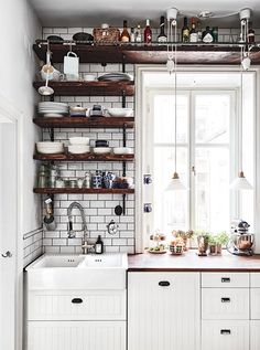 Tiny House Kitchen Ideas - Pick your preferred tiny house kitchen by leaving a comment at the end of this post. Which one of these tiny kitchen areas will get all the votes? Kitchen Shelves, Kitchen Cabinets, Wall Shelves, White Cabinets, Kitchen Backsplash, Wooden Shelves, Kitchen Storage, Metal Cabinets, Glass Shelves