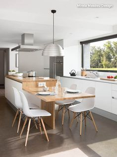 great idea - dining table integrated with the kitchen bench top