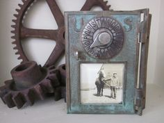 Old brass door from a post office box...great photo frame