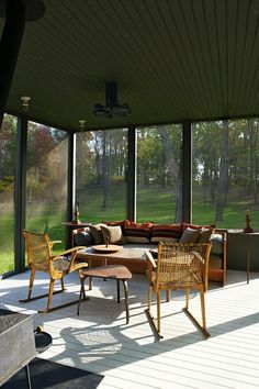 Nothing accentuates the beautiful view of your home better than minimalist home decor. Take this stunning screened-in porch for instance! By pairing a bold yet natural color scheme with mid-century modern furniture, you can recreate this stylish entertaining space for yourself.
