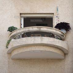 A balcony on the Bauhaus style Zitter House at 6 Mendelsohn Street built by architect Gershon Stempler in 1937. Tel Aviv