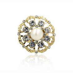 "Fiorella. Dazzling rhinestones with centred faux pearl. Medium weight. Band width: 0.4cm (.2""). Décor diameter: 3.5cm (1.4""). Size: UK-Q / US-8"