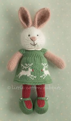 beautiful knitted animals. Lovely little dresses. Wish she'd make patterns for different clothes. I have her patterns for the different animals.