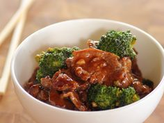 Beef with Broccoli : The ultimate in quick-fix cooking, Ree's 15-minute dinner is packed with the bold flavor of a double-duty sauce made with soy sauce, brown sugar and ginger. This salty-sweet mixture not only marinates the flank steak, but also serves as the base of the cooking liquid.
