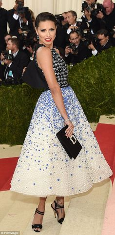 Pretty woman: Model Adriana Lima looked simply gorgeous in a prom style sequin-embellished...