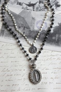 Divine Love-Vintage assemblage necklace by frenchfeatherdesigns