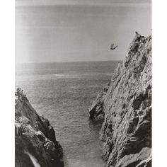 Man diving off a cliff into the sea La Quebrada Acapulco Guerrero Mexico Canvas Art - (24 x 36)