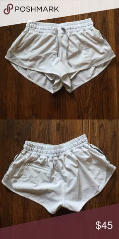 lululemon hotty hot shorts lululemon hotty hot shorts (short length 2.5in) in white and in amazing condition, just a couple little fuzz balls but completely unnoticeable when wearing!!:)) lululemon athletica Shorts