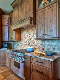 Rustic Neutral Kitchen by designer Heather Guss. I like the color of these cabinets