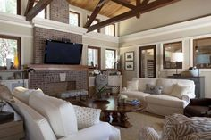 contemporary living room with vaulted ceiling exposed dark wood beams