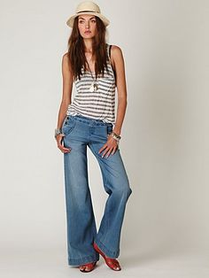 FP Sailor Relaxed Flare  High waisted sailor jeans with button closure at both hips and back slit pockets.