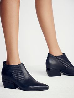 Outerbanks Ankle Boot | This ultra-modern take on a western ankle boot features leather uppers with hand-stitch detailing and sculptural heels.