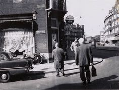 1960's. View on the crossing Elisabeth Wolfstraat and De Clercqstraat in Amsterdam-West. The Elisabeth Wolfstraat crosses the De Clerqstraat and run parallel with the Bilderdijkkade. The De Clercqstraat runs between the Singelgracht and Kostverlorenvaart. Before construction at the end of the 19th century the street was a canal, which was filled-in in 1895. #amsterdam #1960 #ElisabethWolfstraat