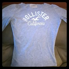 Medium Hollister long sleeve shirt Lightly worn. Lettering is cracked due to the dryer machine. Slight knick in the left underarm. Hollister Tops Tees - Long Sleeve