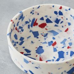 Small bowl by Sevak-Zargarian | £60.00 | Striking terrazzo style porcelain bowl from the Unearthed Interiors collection, with blue and red speckles. Made using parian, and polished to a smooth marble-like finish.