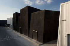 Completed in 2017 in Dubai, United Arab Emirates. Images by Mohamed Somji, courtesy Alserkal Avenue. Located in Dubai's Al Qouz industrial area, Alserkal Avenue was founded in 2007 with the aim of promoting cultural initiatives in the region. Magazine Architecture, Black Architecture, Modern Architecture Design, Cubic Architecture, Factory Architecture, Classical Architecture, In Dubai, Dubai Art, Dubai 2017