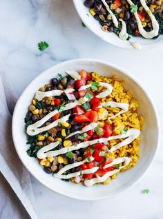 Turmeric Rice Burrito Bowls- seasoned lentils with kale, black beans, and pico de gallo served on a bed of turmeric rice. Topped with vegan cashew cheese for ultimate burrito bowl bliss! Turmeric in a burrito bowl? Yep, you read that right. I know it sounds like they shouldn't go together but trust me, they do. …