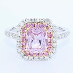This Pink Sapphire Engagement Ring is a pristine, custom made ring from our…