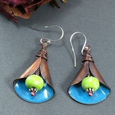 Blue Enameled Copper Lily earrings with handmade lampwork beads in green with white polka dots.  The earrings are o...