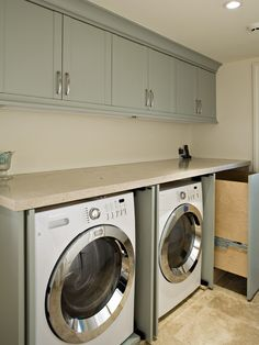 The counter top on the washer and dryer will make the new laundry room more functional.