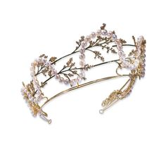 ART NOUVEAU TIARA, MABE PEARL, ENAMEL AND DIAMOND BY LALIQUE Decorated with green enamel flowers set with small twigs old round diamonds woven into a garland of mabe pearls, yellow gold mount