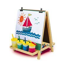 "Table Top Easel by Constructive Playthings. $39.99. Measures 18"" L x 1 3/8"" W x 17 ½"" H. Hardwood 3-way Easel. Paint cups & accessories sold separately. Minimal assembly. Ages 3 yrs. +. Bring artistic fun to the table with this economical, hardwood 3-way Easel. It has a chalkboard on one side, a wipe-off marker board on the other, and it is a painting easel when paper is added (2 plastic clips included.) Measures 18 L. x 1 3/8"" W. x 17 1/2"" H. (Paint cups & acce..."