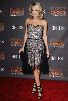 Carrie Underwood Cocktail Dress - At the 2010 People's Choice Awards, Carrie wore a chic black and ivory cocktail dress with a netted overlay.