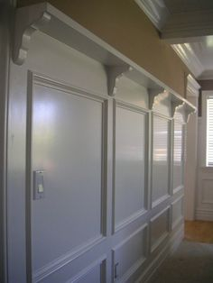 wall-panels-wainscoting-idea | Add kids framed pics with hooks just below and you have a nice bag wall. Just needs a bench with under storage baskets