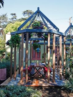 "A Gazebo Fit for Stargazing--The macrame ""roof"" on this backyard gazebo allows ample light to filter through. Look up and it's also a focal point, creating a unique ""spider-web"" pattern that's studded with lush hanging baskets."