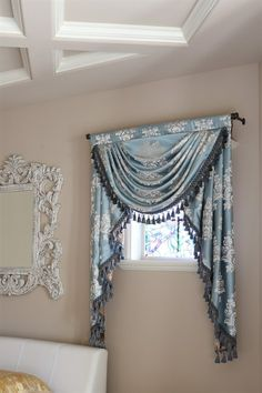 Glacial Swan swag valance curtains This stunning valance brings a refreshing yet noble lustre to the surrounding. The silky fabric reminds of a herd of graceful swans floating on a peaceful glacial lake under clean blue sky.