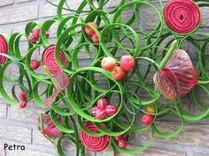 Rings of wide winding wire, Wicker, Malus ' Red Sentinel ', Diplocyclos palmatus, red Anthurium, Lilium leaves and red felt