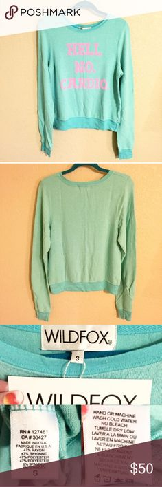 """❗️FINAL PRICE❗️NWT Wildfox Hell No Cardio Jumper Brand new with tags authentic Wildfox Couture baggy beach jumper. Ice blue color with neon pink lettering. Super soft and comfy! Approx 24"""" long, 19"""" across chest. Size XS & S available. ❌No trades❌Price firm unless bundled. Wildfox Sweaters Crew & Scoop Necks"""