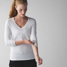 NWT Lululemon V-Neck Tee Super soft and comfortable Pima cotton, thin holes and shaped hem for a little extra coverage during practice. Price firm. No trades. lululemon athletica Tops Tees - Long Sleeve