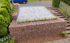 Low Cost gabion car park retaining wall Cheaper than block stone gabion walls are easy to build  http://www.gabion1.co.uk