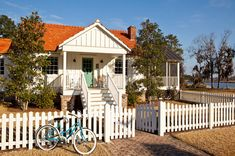 Exterior Design, Fabulous Small Farmhouse With Traditional Exterior Design Also White Picket Fence And Gate Designs With Bricks Entry Floor And Classic Bicycle With Blue Color And Green Wooden Front Door Color: Concrete and Picket Modern Fence Design Southern Cottage, Cozy Cottage, Cottage Living, Cottage Style, Coastal Cottage, Coastal Living, Cottage Ideas, Coastal Style, House Of Turquoise