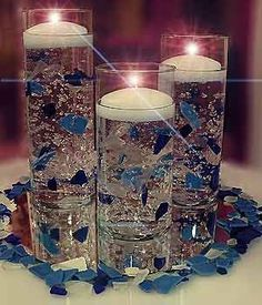I've done this several times and suspended gold hearts, colored gems, grapes, etc. It really is a great, different look that always has your guests trying to figure out how it's done! #floatingcandles