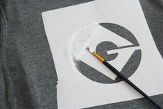 painting Despicable Me logo for Minion costume