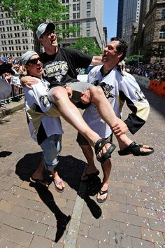 Max Talbot and Bill Guerin give coach Dan Bylsma a lift at the Pens Cup Parade, June, 2009.